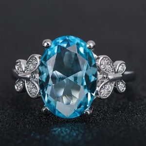 White Gold Blue Diamond Solitaire Engagement Ring